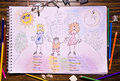 Lesbian family different children draw on wood table Stock Image