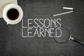 Lessons learned concept on black blackboard Royalty Free Stock Photo