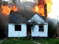 Let it burn firefighters watch as fire consumes house rather then risk more lives on fighting a fire that s just not worth the Royalty Free Stock Image