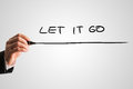 Let it go man writing the words with a black marker pen from behind a virtual screen or interface on a light grey background with Stock Images