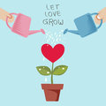 Let love grow couple in a pot watered from a watering can Royalty Free Stock Image