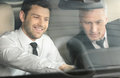 Let me show you all the features handsome young classic car sal salesman sitting at front seat of showing to Royalty Free Stock Photo