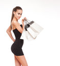 Let s go shopping portrait of a gorgeous young brunette holding bags Royalty Free Stock Image