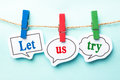 Let us try tryconcept paper speech bubbles with line on the light blue background Royalty Free Stock Image