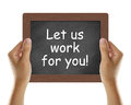Let us work for you written on blackboard with hands holding it Royalty Free Stock Image