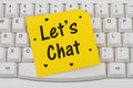 Let's Chat, computer keyboard and sticky note Royalty Free Stock Photo