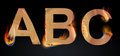 Letras de queimadura do ABC Fotografia de Stock
