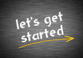 Lets get started written on blackboard Stock Photography