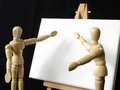 Lets look at it two mannequins acting out a management scenario in front of a white board Royalty Free Stock Photography