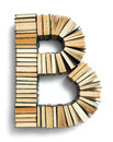 Letter b formed from the page ends of books closed vintage hardcover standing on a white background a set or series Royalty Free Stock Image