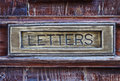 Letter box close up brushed copper and old painter wood Stock Image
