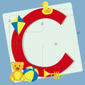 Letter c from stylized alphabet with children's toys Royalty Free Stock Photo