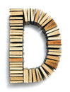 Letter d formed from the page ends of books closed vintage hardcover standing on a white background a set or series Royalty Free Stock Image