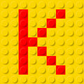 Letter k in construction kit red yellow plastic typeface sample Royalty Free Stock Image