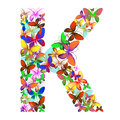 The letter K made up of lots of butterflies of different colors