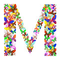 The letter M made up of lots of butterflies of different colors