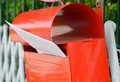 Letter in red post box on home fence Royalty Free Stock Photo
