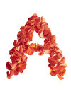 Letter a of rose petals isolated on white background Royalty Free Stock Photo