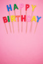 Letter-shaped happy birthday candles Royalty Free Stock Photo