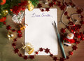 Letter to santa claus dear santa christmas still life and background a sheet of paper on a wooden table with ornaments Stock Image