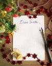 Letter to santa claus dear santa christmas still life and background a sheet of paper on a wooden table with ornaments Royalty Free Stock Image
