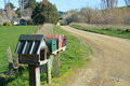 Letterboxes on a dirt farm road north canterbury new zealand beside Royalty Free Stock Image