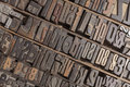 Letterpress alphabet collection of various wood type letters for printing Stock Image