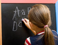 Letters of the alphabet schoolgirl writes Stock Photography