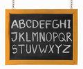 Letters of English alphabet capital on blackboard Royalty Free Stock Photos