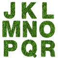 Letters j k l m n o p q r made of green grass isolated on white Stock Photos
