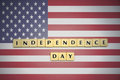 Letters with text independence day on the national flag of united states of america. Royalty Free Stock Photo