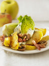 Lettuce with pan-fried apples and diced bacon Stock Photo