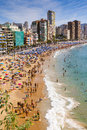 Levante beach of benidorm costa blanca spain famous spanish resort full tourists swimming and sunbathing Stock Photos