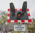 Level crossing warning sign railway with flashing lights Royalty Free Stock Photography