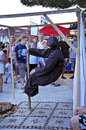 Levitation trick krk croatia august unknown artist performing in the front of curious tourists on august in krk croatia Stock Photo