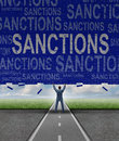 Lfting sanctions lifting as a global economic symbol for solutions to trade disputes as a man lifting a brick wall with words as a Stock Image