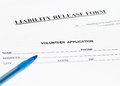 Liability release form up close photo of with blue pen Royalty Free Stock Photography
