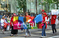 Liberal pride members of the party carrying the flag at edmonton s parade Royalty Free Stock Photo