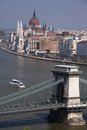 Liberty bridge over the danube river in budapest with the hungarian parliament building in the background Stock Photo