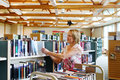 Librarian replacing books on shelves Royalty Free Stock Photo