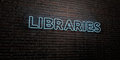 LIBRARIES -Realistic Neon Sign on Brick Wall background - 3D rendered royalty free stock image Royalty Free Stock Photo