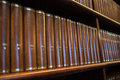 Library book shelf in a church full with brown books Royalty Free Stock Image