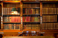 Library shelves and table Royalty Free Stock Images