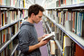 Library student reading book in university education Royalty Free Stock Photography