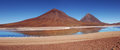 Licancabur volcano in bolivian altiplano with blue lagoon in foreground Royalty Free Stock Image