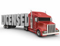 Licensed d word certified trained truck driver in letters hauled by a or red Stock Photo