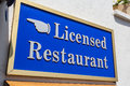 Licensed restaurant a sign indicating that a is Stock Photography