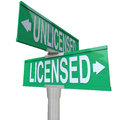 Licensed vs unlicensed signs choose official words on two way green road or street to illustrate choosing a certified or Stock Photos
