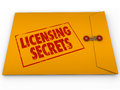 Licensing secrets yellow envelope help advice words on a confidential classified to illustrate tips and information about getting Stock Photography
