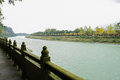 Lichen covered stone balustrade of riverside footway in cloudy a the afternoon dujiangyan china Stock Photography